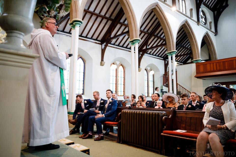 Rev Michael Hopkins greets guests ahead of the wedding ceremony
