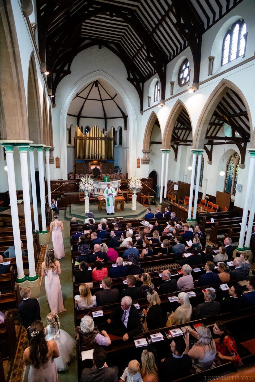 Bridesmaids making their entrance at Farnham United Reform Church