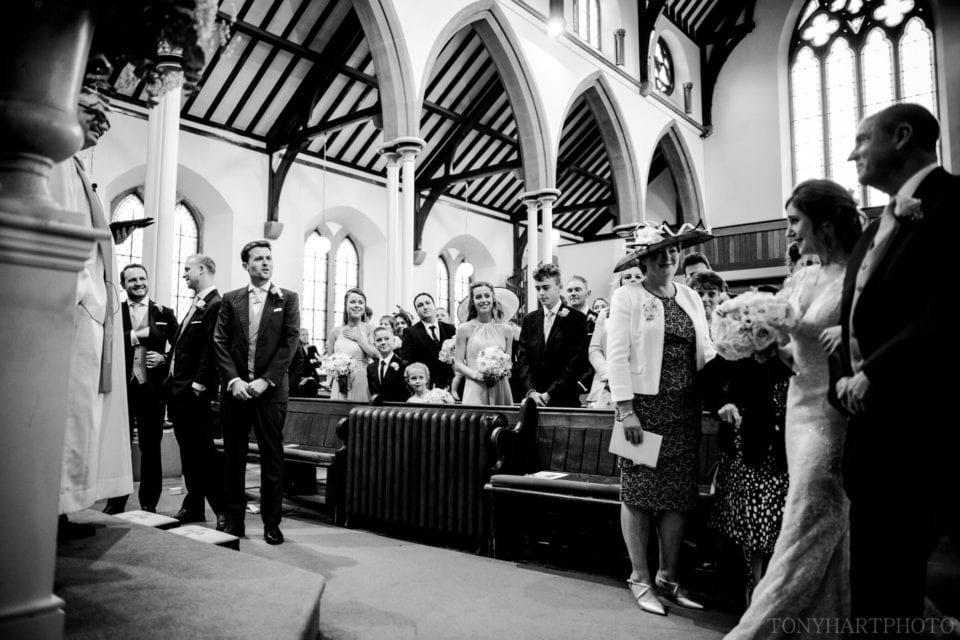First look at Farnham URC between Bride and Groom