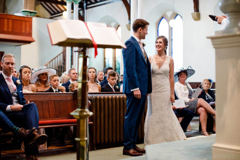 Lauren & Scott during the church portion of their Farnham Castle wedding