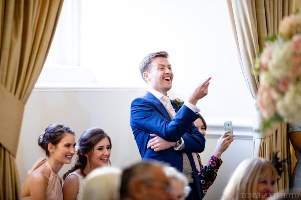 Groom reacts during the speeches at Farnham Castle