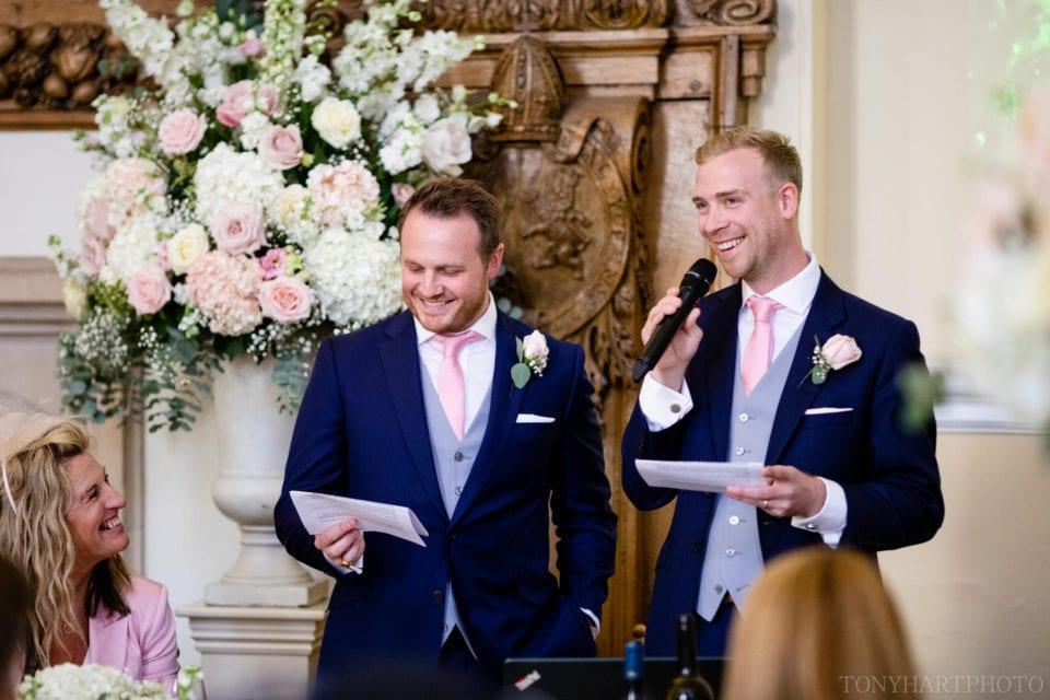 Best Men giving their speech in the Great Hall at Farnham Castle