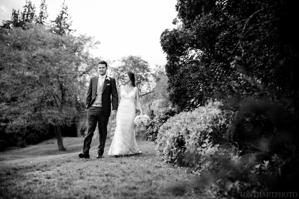 Lauren & Scott taking at stroll in the Rose Garden
