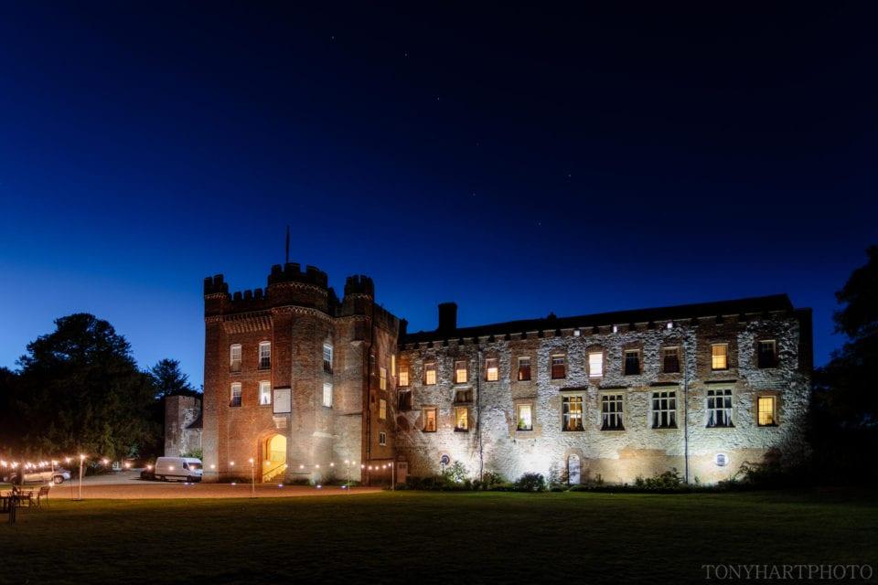 Farnham Castle underneath starry skies.