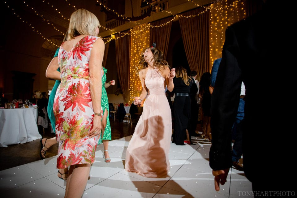 Bridesmaid dancing at Farnham Castle