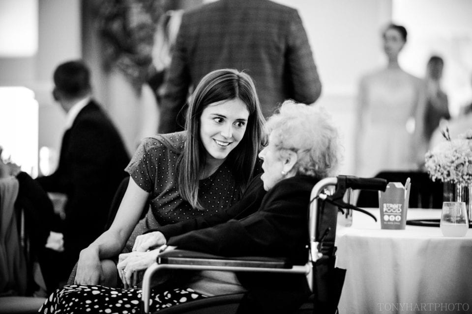 Granny chats to a wedding guest