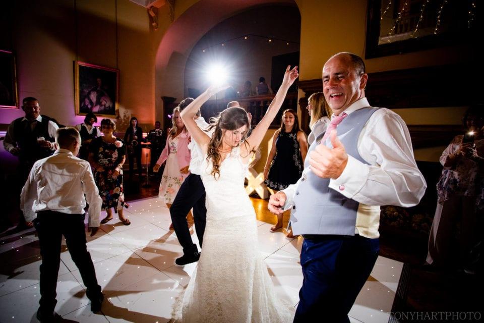 Lauren throwing shapes during her wedding at Farnham Castle