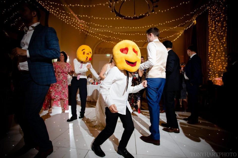 Emoji faces on the dancefloor at Farnham Castle